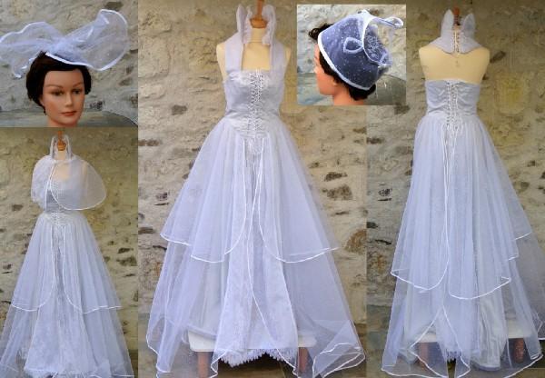 Robe de mariée inspiration renaissance réalisée en tulle pailleté gris et dentelle.Elle est doublée en viscose gris perle.